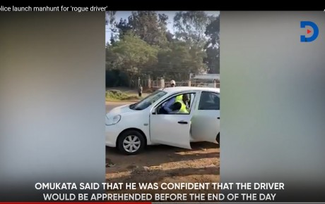 Video – This private motorist who beat the hell out of a traffic cop is on the run