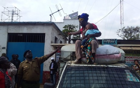 Video – Breastfeeding hawker stages protest on top of kanjo pickup in Nairobi CBD